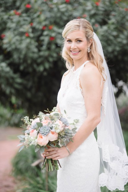 Love the romantic and pastel tones of this bridal bouquet, filled with peach Juliets, Dusty Miller, Greens, and Succulents.