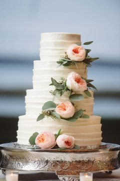 Designed this cake's floral with Juliets and Euchs in perfectly placed groupings to tie in all the colors of the wedding.