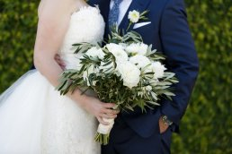 Loose & Airy Bridal Bouquet with Olive Branches, White Ranunculus, White Garden Roses, and White Peonies.