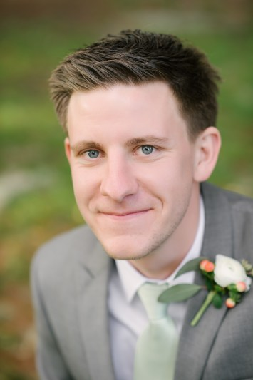 Our Groom with his White Ranunculus, Peach Hypericum, and Euch filled boutonniere.