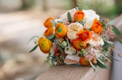 Citrus themed bouquets filled with Orange Ranunculus, Peach Garden Roses, Peach Hypericum Berry, Ivory Standard Roses, and Seeded Euch.