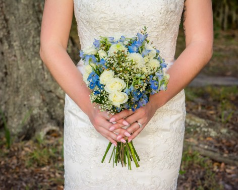 Our bride with her white Wildflower Bridal Bouquet with pops of Blue Delphinium and Corn Flower.