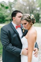 Our bride and groom, Samantha and Michael. Samantha's hair piece is filled with blush ranunuclus, baby blue eucalyptus, and white alstroemeria. Michael's boutonniere is designed inside a shotgun shell with blush spray roses and blush astilbe.