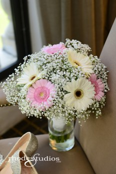 Bridal bouquet filled with babies breath and blush and white gerber daisies.