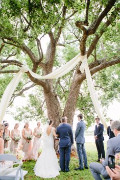 Ceremony was set with a dramatic drape from the tree that was planted the same year the bride was born.