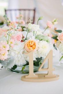 Centerpieces of Juliet garden roses, spray roses, queens ann lace, eucalyptus, hydrangea and stock.