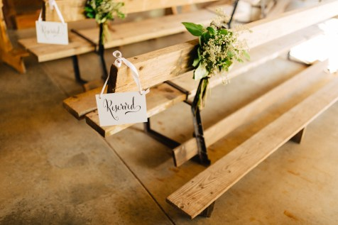 Aisle markers of greens was appropriate for this rustic but elegant wedding.
