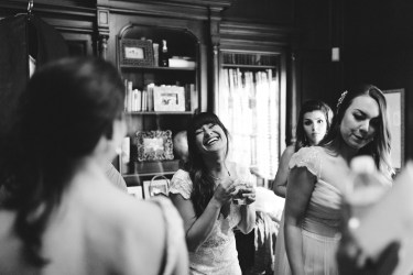 Bridal ready room enjoying some moments with her maids.