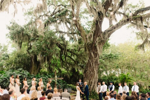 Ceremony set under the large oak tree with spanish moss.