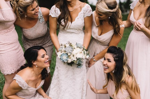 Bride and her maids enjoying a laugh or two.