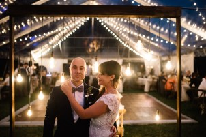 Picturesque setting with market lighting under a clear tent.