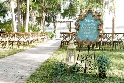 Ceremony of greenery, chalk boards and lanterns.