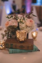 Centerpieces with white hydrangea, ranunculus, garden roses, spray roses, and eucalyptus.
