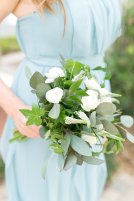 Maids bouquet of white ranunculus and veronica complimented with greens for a garden feel.