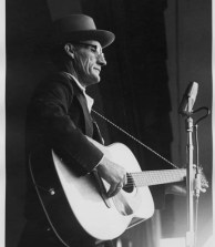 Roscoe Holcomb with guitar