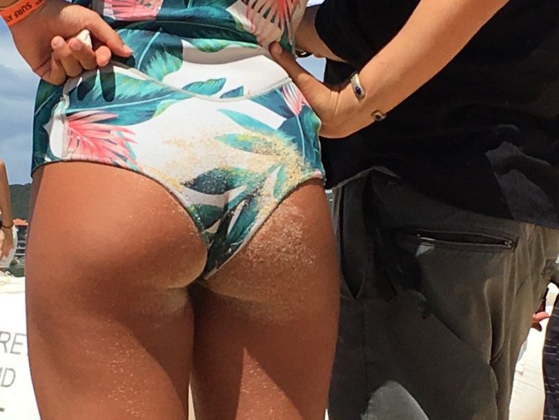 young female pro surfer butt with wax