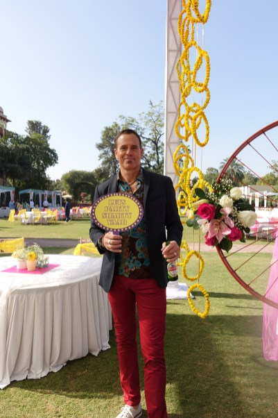 Man at garden party with sign