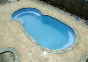 in ground swimming pool builder Michigan Clarston, Milford, Fenton, Oxford, Lansing, Shelby Mi. inground Swimming pool Installation Clarkston Michigan Swimming Pool Sale www.bluehawaiianpoolsofmichigan.com 12 - blue hawaiian pools of michigan sea swirl pool 06a