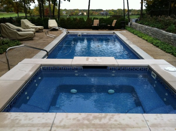 in ground swimming pool builder Michigan Clarston, Milford, Fenton, Oxford, Lansing, Shelby Mi. inground Swimming pool Installation Clarkston Michigan Swimming Pool Sale www.bluehawaiianpoolsofmichigan.com 13 - 1165