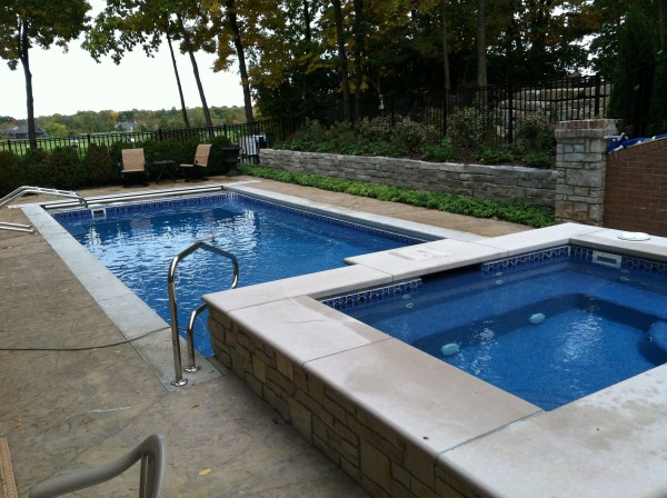 in ground swimming pool builder Michigan Clarston, Milford, Fenton, Oxford, Lansing, Shelby Mi. inground Swimming pool Installation Clarkston Michigan Swimming Pool Sale www.bluehawaiianpoolsofmichigan.com 13 - 1166