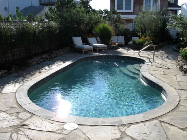 in ground swimming pool builder Michigan Clarston, Milford, Fenton, Oxford, Lansing, Shelby Mi. inground Swimming pool Installation Clarkston Michigan Swimming Pool Sale www.bluehawaiianpoolsofmichigan.com 13 - 1196