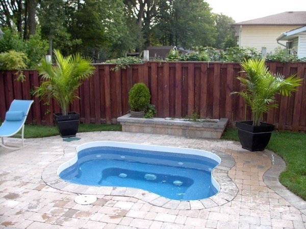 in ground swimming pool builder Michigan Clarston, Milford, Fenton, Oxford, Lansing, Shelby Mi. inground Swimming pool Installation Clarkston Michigan Swimming Pool Sale www.bluehawaiianpoolsofmichigan.com 13 - 1219