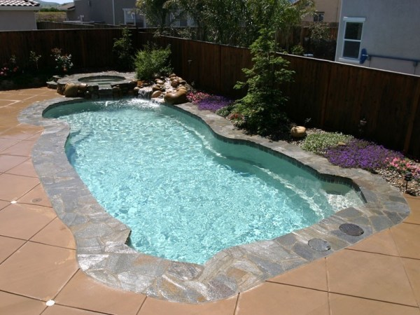 in ground swimming pool builder Michigan Clarston, Milford, Fenton, Oxford, Lansing, Shelby Mi. inground Swimming pool Installation Clarkston Michigan Swimming Pool Sale www.bluehawaiianpoolsofmichigan.com 13 - 1235
