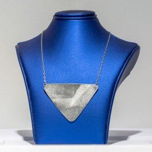 Rhodium Triangular Necklace on a blue display element.