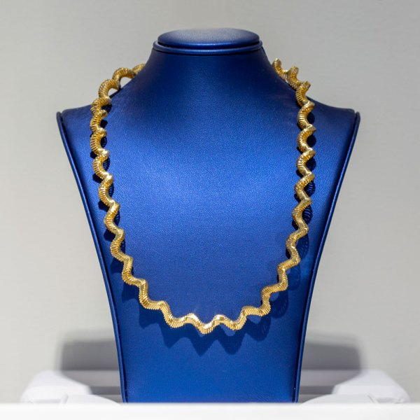 Yellow Gold Twisted Necklace on a blue display element.