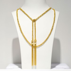 Yellow Gold Mesh Lariat with Tassels Necklace on a white display element.