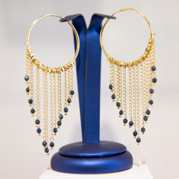 18KY Plated Bead Dangles from Hoop Earrings on an element.