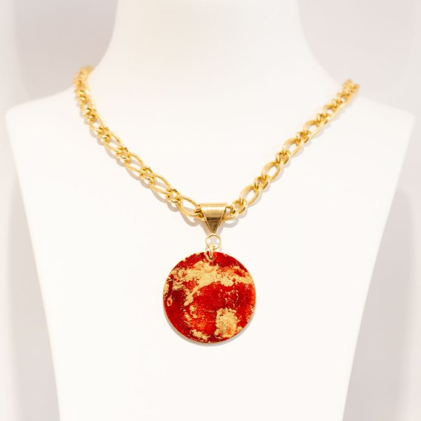 Fire Bold Pendant Necklace on a display element.