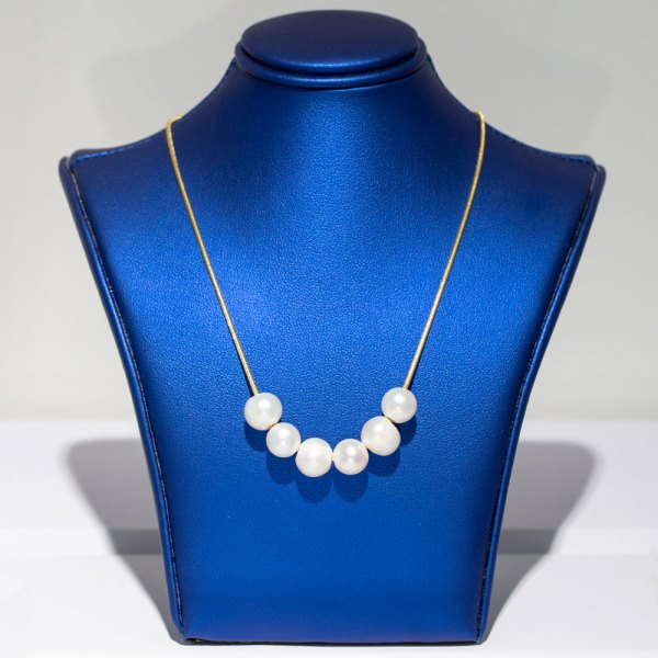 Yellow Gold 6 Pearl Strand Necklace front view on a blue display element.