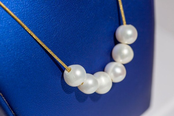 Yellow Gold 6 Pearl Strand Necklace close up angle view.