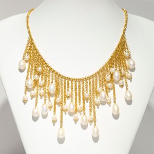 Yellow Gold Floating Pearl Dangles Necklace on a white display element.