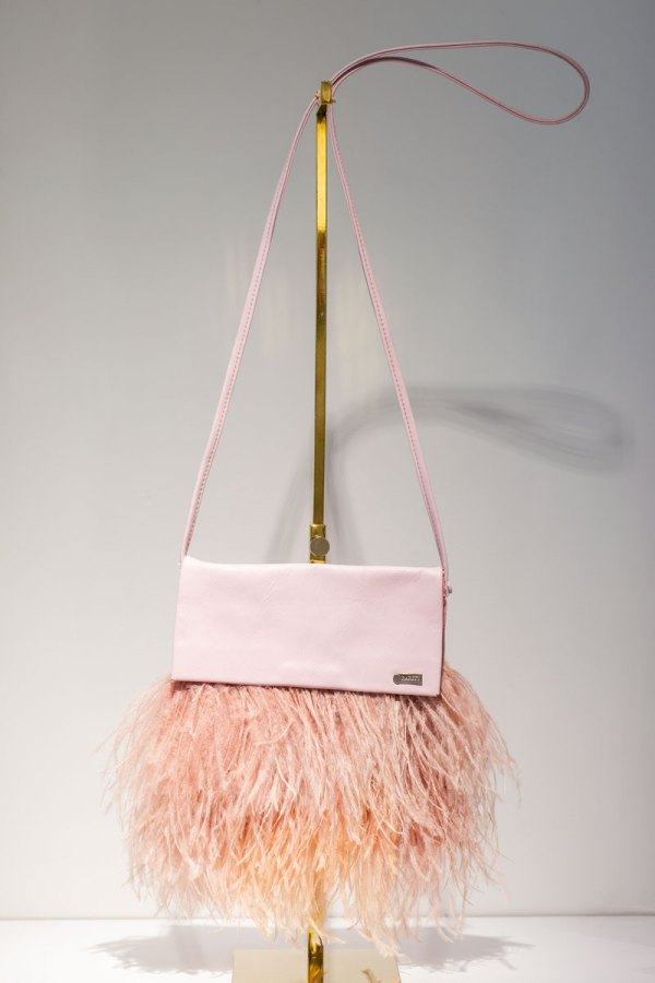 Blush Feather Tiffany Bag front view hanging from a gold stand.