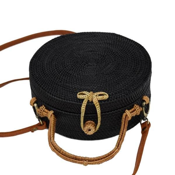 Black Milly Bag with Natural Exterior angle view with leather strap attached.