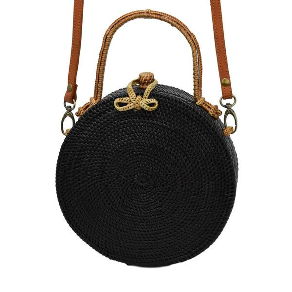 Black Milly Bag with Natural Exterior front view with leather strap attached.