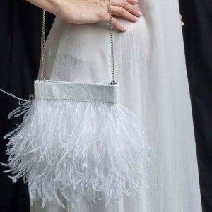 White Ostrich Feather Handbag close up on a models side.