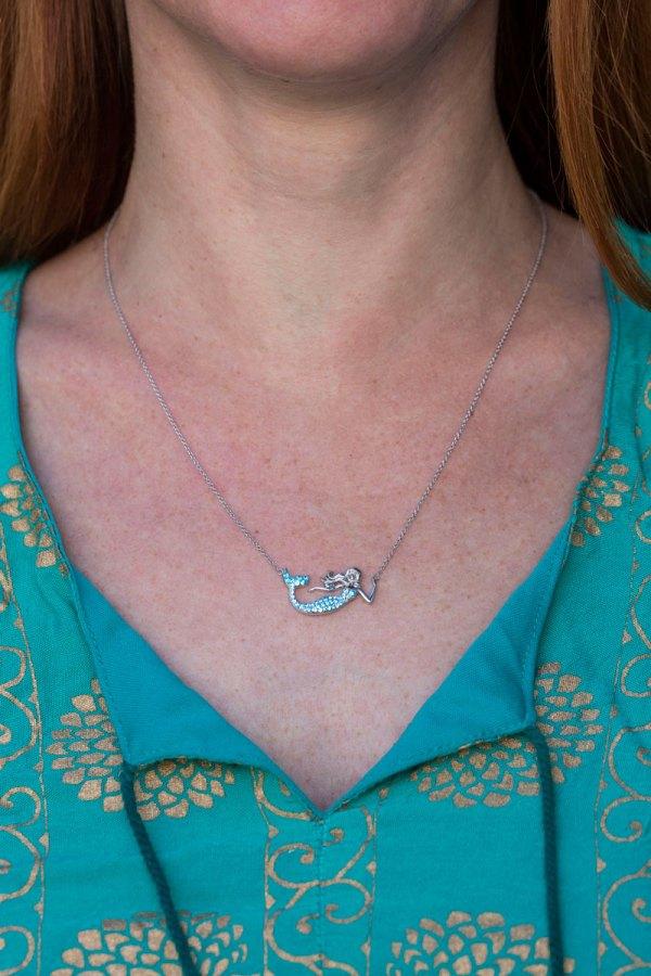 Aqua Mermaid Necklace on a model.