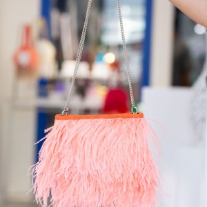 Coral Fancy Bag with Chain held in a models hand with shortened chain handle.