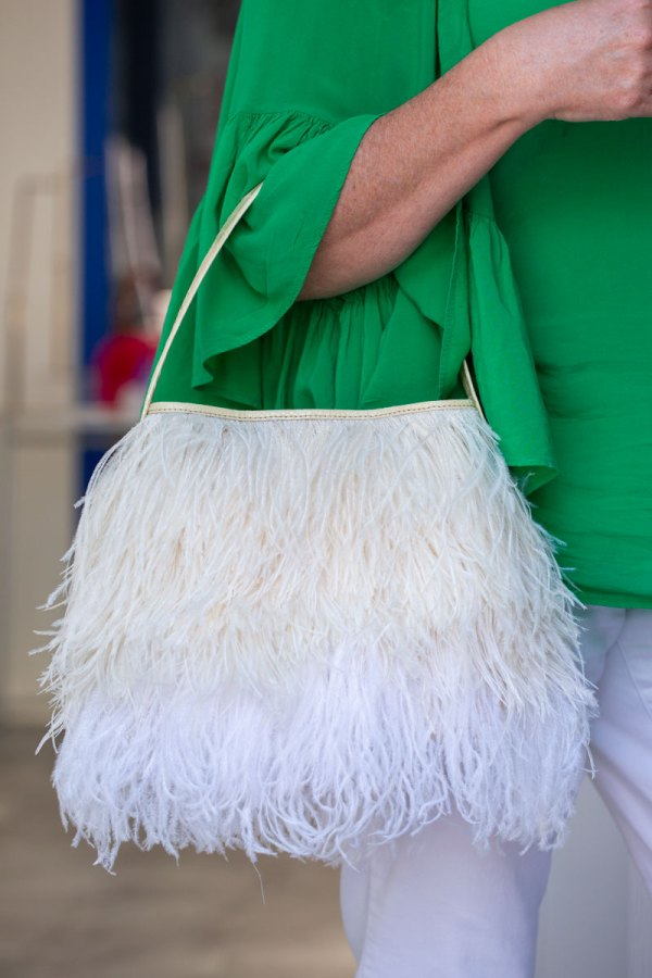 Cream/White Shayleen Purse on a models arm.