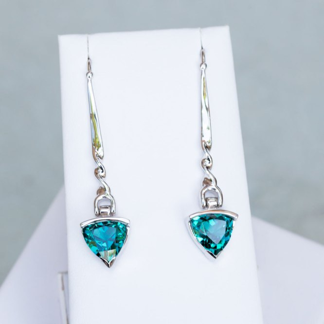 Trillion Cut Caribbean Blue Quartz Earrings front view on a white display element.