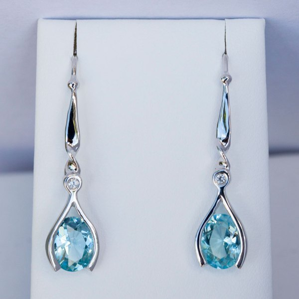 Aqua Topaz Earrings with White Sapphires front view on a white display element.