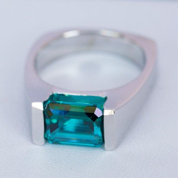 Emerald Cut Caribbean Blue Quartz Ring cross view.