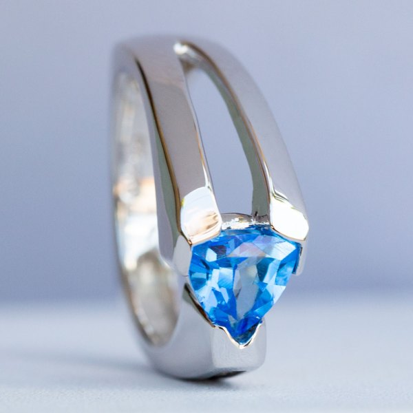 Kashmir Blue Topaz & White Sapphire Ring standing on its side top view.