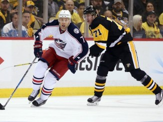 Blue Jackets' Jack Johnson and Pittsburgh's Evgeni Malkin