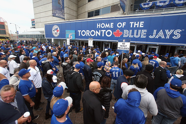 TORONTO, ON - OCTOBER 20: Fans enter the stadium for the game between the Kansas City Royals and the Toronto Blue Jays during game four of the American League Championship Series at Rogers Centre on October 20, 2015 in Toronto, Canada. (Photo by Tom Szczerbowski/Getty Images)