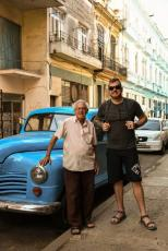 With an old grandpa and his blue vintage car