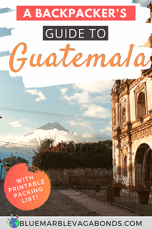 Guatemala backpacking tips Pin - old building in Antigua and volcano in the distance